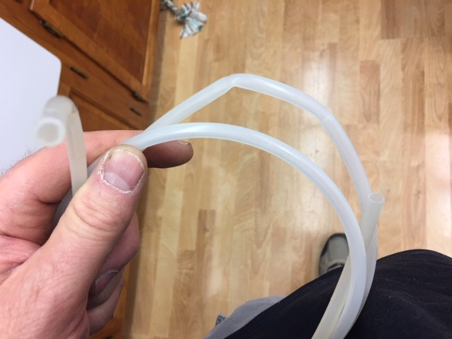 Refrigerator dispenser tubing